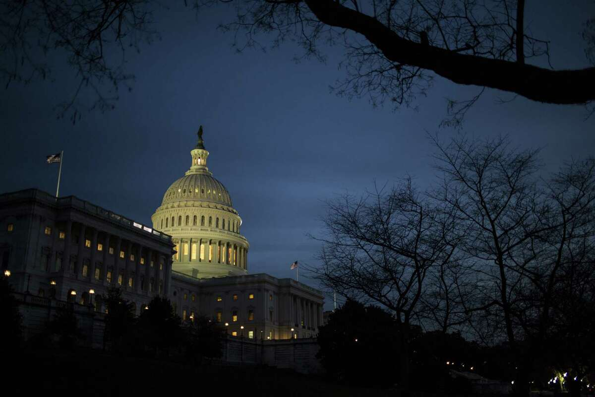 The U.S. Capitol building stands in Washington, D.C., on Tuesday, Dec. 19, 2017. Photographer: Zach Gibson/Bloomberg