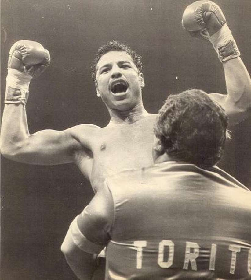 Tony Ayala Jr. celebrates with his father, Tony Sr., after a boxing victory in 1982. Photo: Express-News Archives