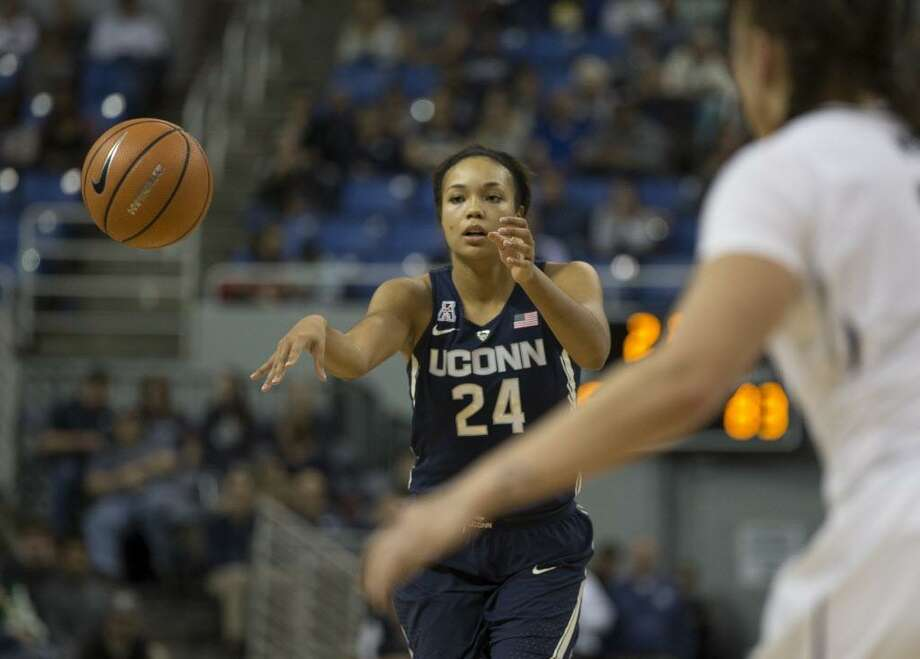 UConn's Napheesa Collier passes the ball against Nevada in a Nov. 28 game. Photo: Tom R. Smedes / Associated Press / FR171463 AP