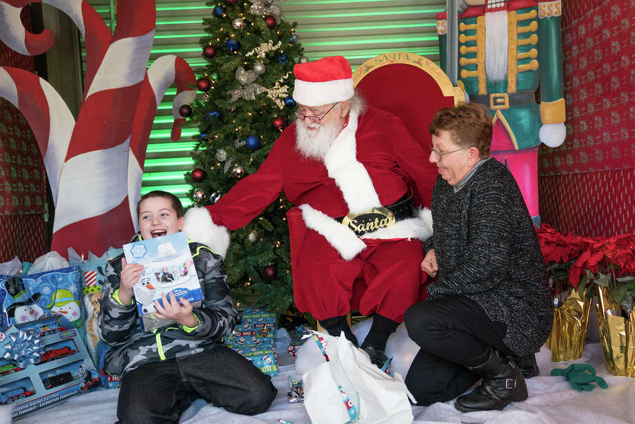 A gift certificate and items valued at a total of  $2,500 provided through an Extra Space Storage contest are providing a bright end for what had been a grim year for Alvin resident Wendy Christoph and her grandson Dean Larson. Christoph has struggled after Hurricane Harvey devastated their home and ruined all her grandson's toys. Now, she looks forward to buying a washer and dryer and new toys for Dean.