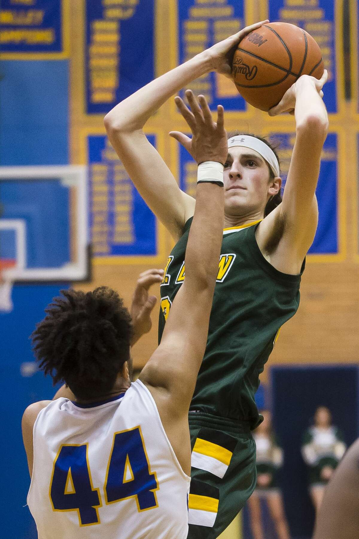 Dow senior Zac Chichester takes a shot during the Chargers' game against Midland on Tuesday, Dec. 19, 2017 at Midland High School. (Katy Kildee/kkildee@mdn.net)