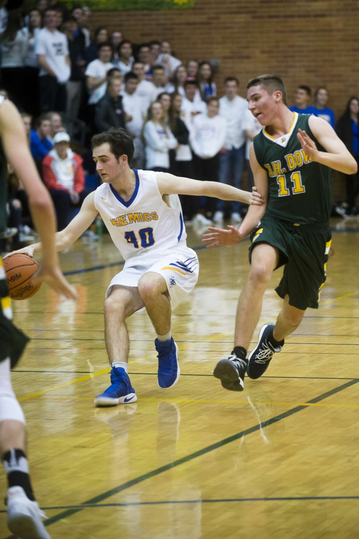 Midland senior Drew Gandy dribbles down the court during the Chemics' game against Dow on Tuesday, Dec. 19, 2017 at Midland High School. (Katy Kildee/kkildee@mdn.net)