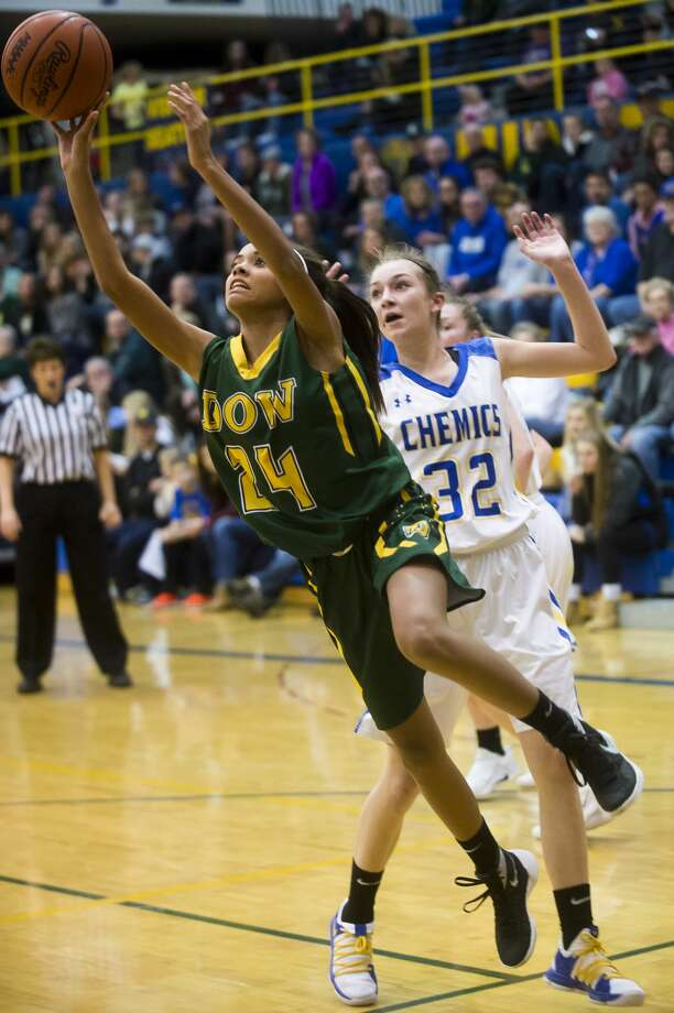 Dow freshman Jada Garner takes a shot during the Chargers' game against Midland on Tuesday, Dec. 19, 2017 at Midland High School. (Katy Kildee/kkildee@mdn.net) Photo: (Katy Kildee/kkildee@mdn.net)
