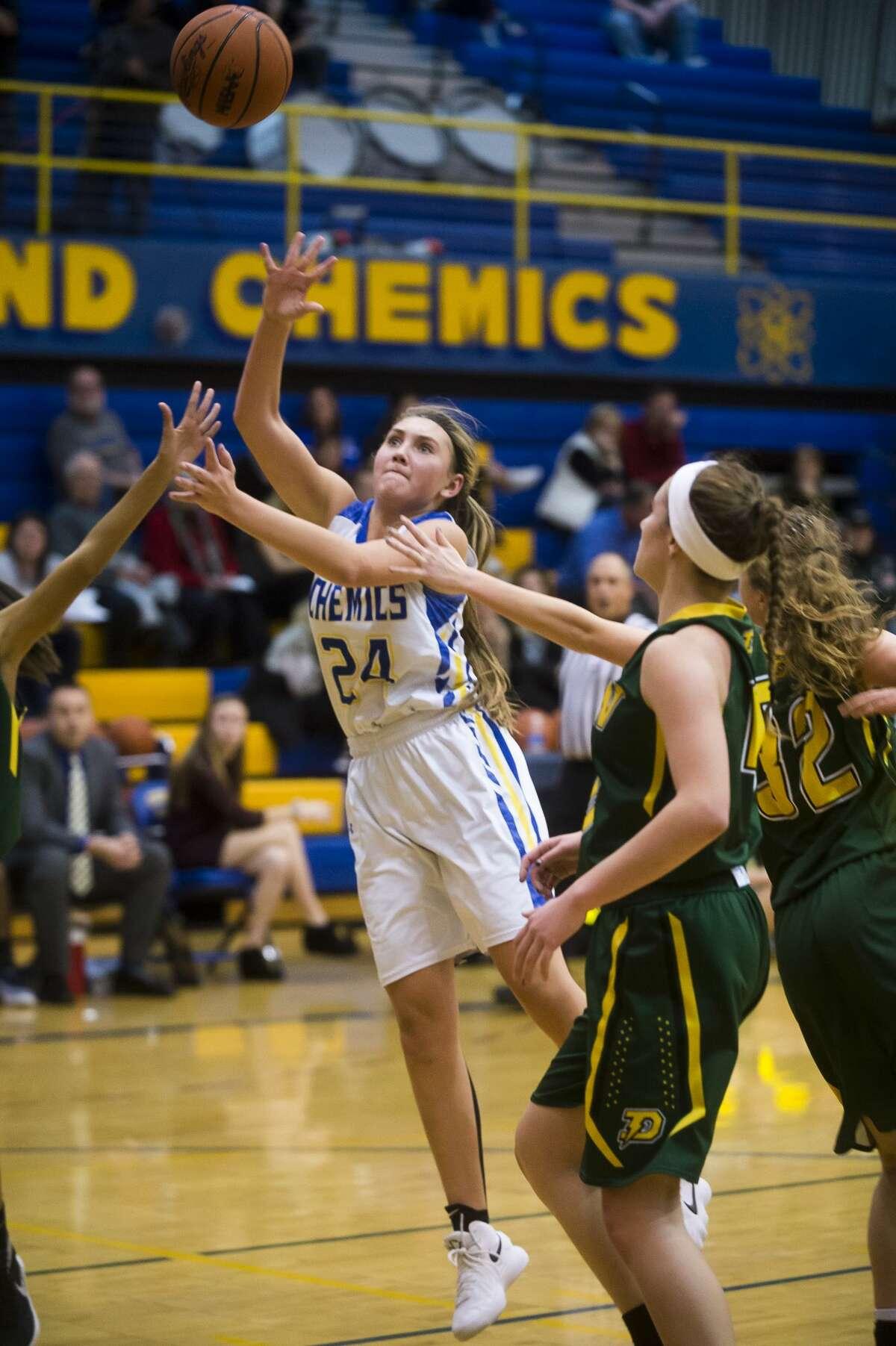 Midland senior Hannah Smith takes a shot during the Chemics' game against Dow on Tuesday, Dec. 19, 2017 at Midland High School. (Katy Kildee/kkildee@mdn.net)