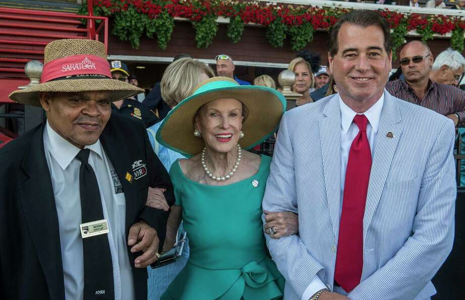 Mary Lou Whitney with husband John Hendricksen, right, heads to the winner's circle to make the presentation for the 90th running of The Whitney Stakes at the Saratoga Race Course  Saturday Aug. 5, 2017 in Saratoga Springs, N.Y.  (Skip Dickstein/Times Union) Photo: SKIP DICKSTEIN