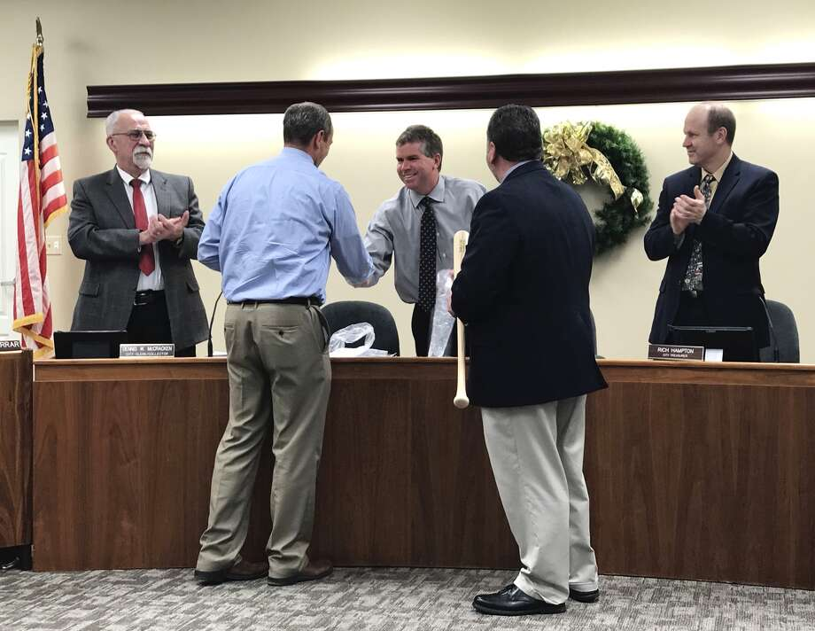 Director of Public Works Eric Williams shook Edwardsville Mayor Hal Patton's hand after being recognized at Tuesday's City Council meeting for his efforts the city's major projects this year. City Administrator Tim Harr was also recognized for his efforts. Photo: Cody King • Cking@edwpub.net
