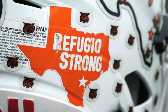 """Bouncing back from hurricane Harvey to play in the 2017 Football Conference 2A D1 tournament at AT&T Stadium on Wednesday, the Bobcats added a """"Refugio Strong"""" sticker to their helmets this season, Sunday, Dec. 17, 2017, in Refugio. ( Hunter Atkins / Houston Chronicle )"""