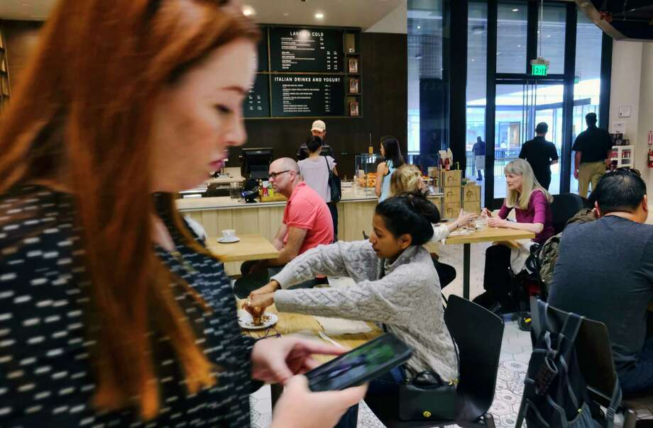 Customers have their morning coffee and pastries at the LaVazza Cafe, at Eataly, at the Westfield Century City Mall in Los Angeles. Many mall owners are adding more upscale restaurants and bars. Photo: Richard Vogel, STF / Copyright 2017 The Associated Press. All rights reserved.