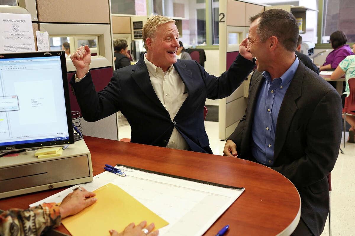FILE - In this Sept. 25, 2015, file photo, Mark Phariss, left, and Victor Holmes celebrate getting their marriage license at the Bexar County Marriage License Office in San Antonio. Phariss, who sued over the right to marry his partner said Tuesday, Dec. 19, 2017, that he is running as a Democrat in 2018 in a bid that would make him the first openly gay state senator in Texas if elected. (Lisa Krantz/The San Antonio Express-News via AP File)/The San Antonio Express-News via AP)