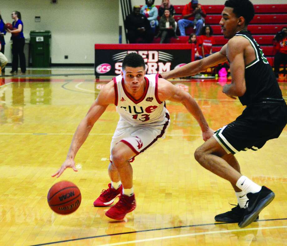 SIUE sophomore point guard Christian Ellis, left, drives to the basket during first-half action against Chicago State on Tuesday inside the Vadalabene Center.