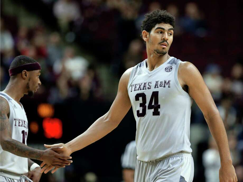 Texas A&M guard Duane Wilson (13) and center Tyler Davis (34) celebrate their 64-58 win over Northern Kentucky during the second half of an NCAA college basketball game Tuesday, Dec. 19, 2017, in College Station, Texas. (AP Photo/Michael Wyke) Photo: Michael Wyke, Associated Press / © Associated Press 2017