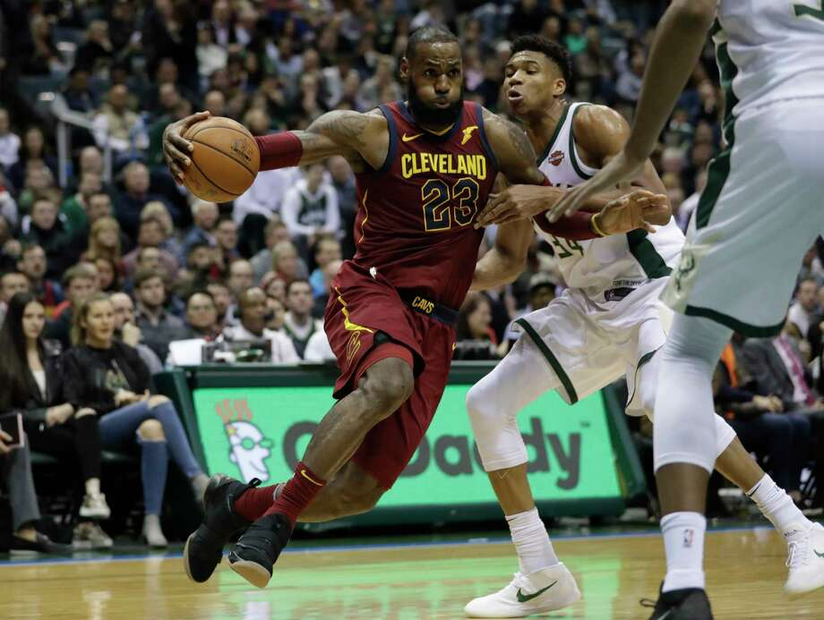 Cleveland Cavaliers' LeBron James drives past Milwaukee Bucks' Giannis Antetokounmpo during the first half of an NBA basketball game Tuesday, Dec. 19, 2017, in Milwaukee. (AP Photo/Morry Gash) ORG XMIT: WIMG112 Photo: Morry Gash / Copyright 2017 The Associated Press. All rights reserved.