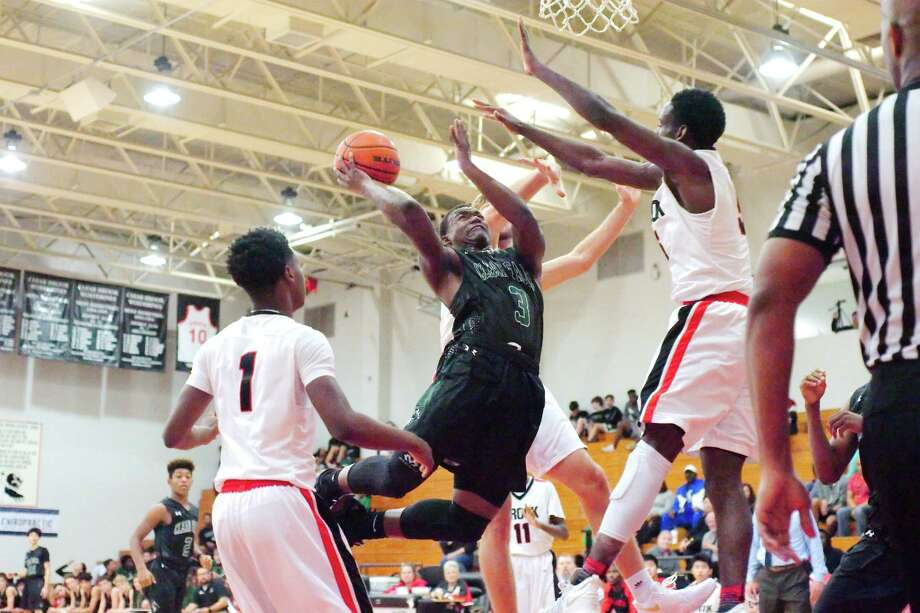 Clear Falls' Camron Davis (3) tries to put up a shot over Clear Brook's Kendrick Christian (5) Tuesday, Dec. 19 at Clear Brook High School. Photo: Kirk Sides / © 2017 Kirk Sides / Houston Chronicle