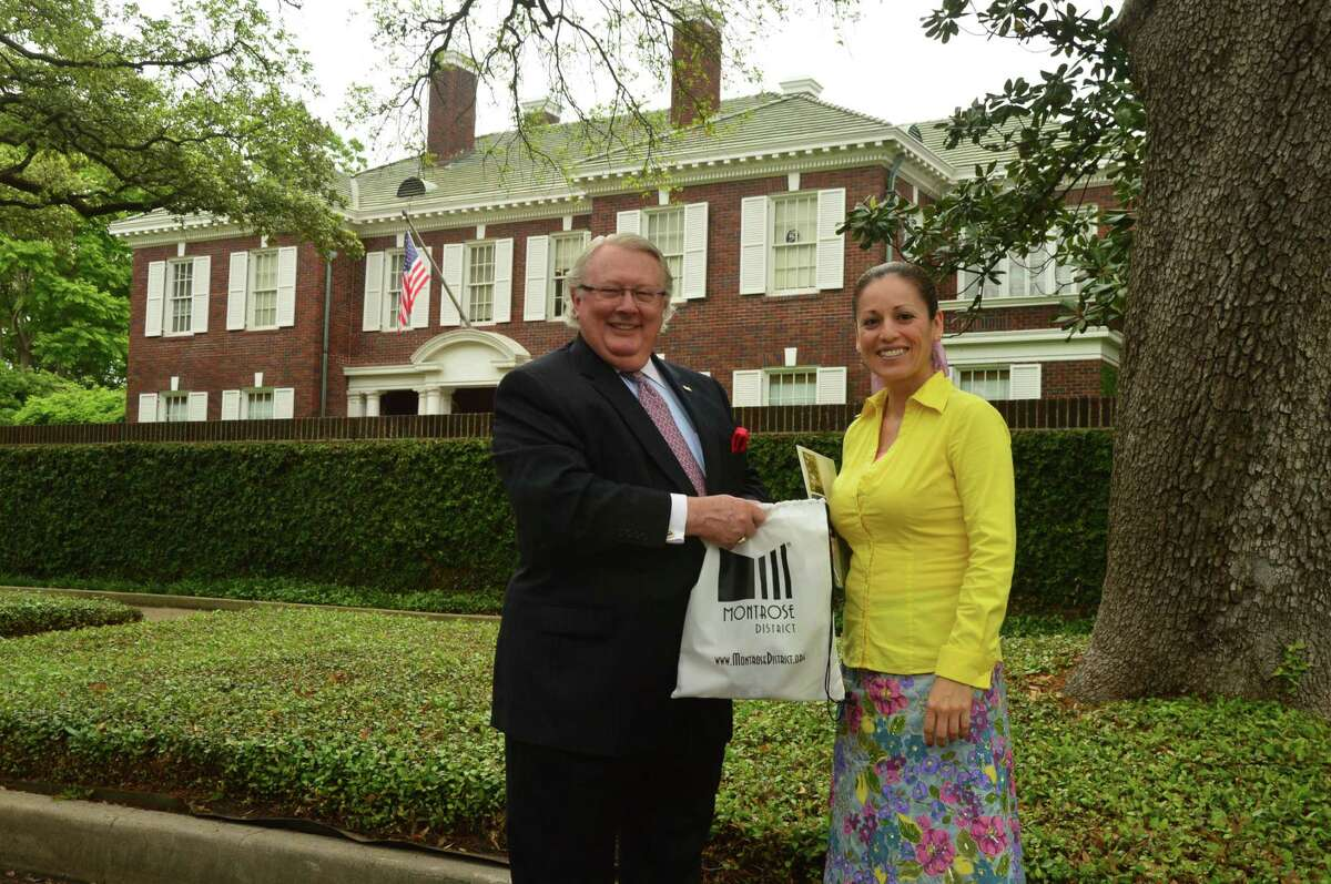 Montrose District Chairman, Claude Wynn and Ambassador Marie Cortes Matte stand in the historic district of Montrose.