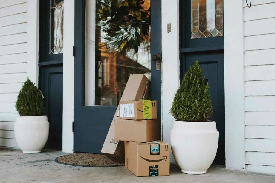 Packages await their owner on a porch in the Annesdale Historic District in Memphis, Tenn.  Homeowners and retailers are striking back with cameras and other technology. Photo: HOUSTON COFIELD, STR / NYTNS