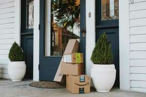 Packages await their owner on a porch in the Annesdale Historic District in Memphis, Tenn.  Homeowners and retailers are striking back with cameras and other technology.