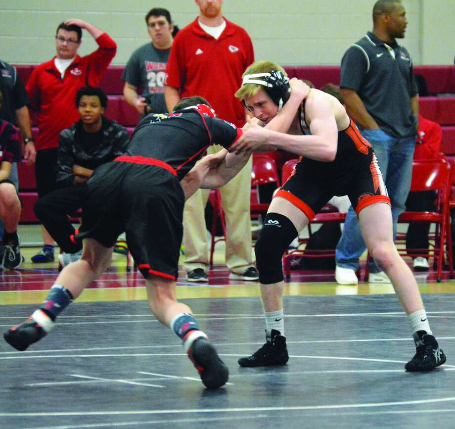 Edwardsville's Noah Surtin, right, wrestles against Granite City during a 120-pound bout in Southwestern Conference action.