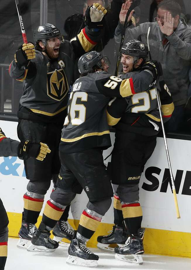 The Golden Knights celebrate after Shea Theodore (right) scored with 3 seconds left against the Lightning. Photo: John Locher, Associated Press