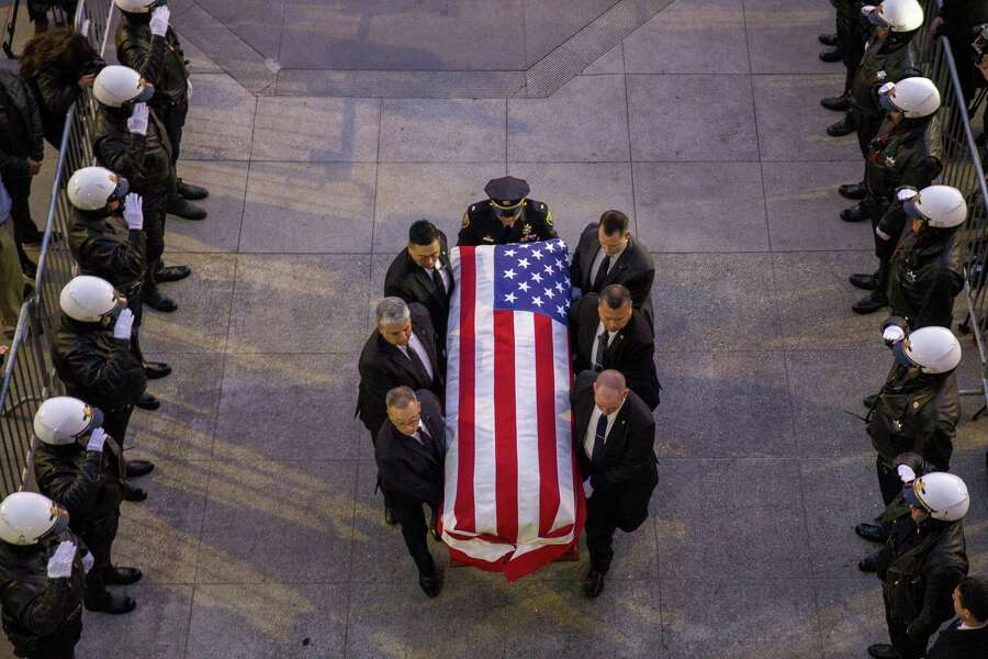 The casket of San Francisco Mayor Ed Lee is carried into San Francisco's City Hall on Friday, December 15, 2017. Mayor Ed Lee was lain in state at the City Hall rotunda. Lee died at the age of 65 following a heart attack on December 12, 2017. Photo: Santiago Mejia / San Francisco Chronicle / San Francisco Chronicle