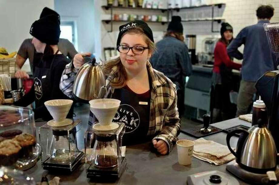 Live Oak Coffeehouse barista Kaitlyn Mercy makes a pour over coffee during the opening day of the coffeehouse located at 711 Ashman. Live Oak is open every day from 6 a.m. to 9 p.m. (Brittney Lohmiller)