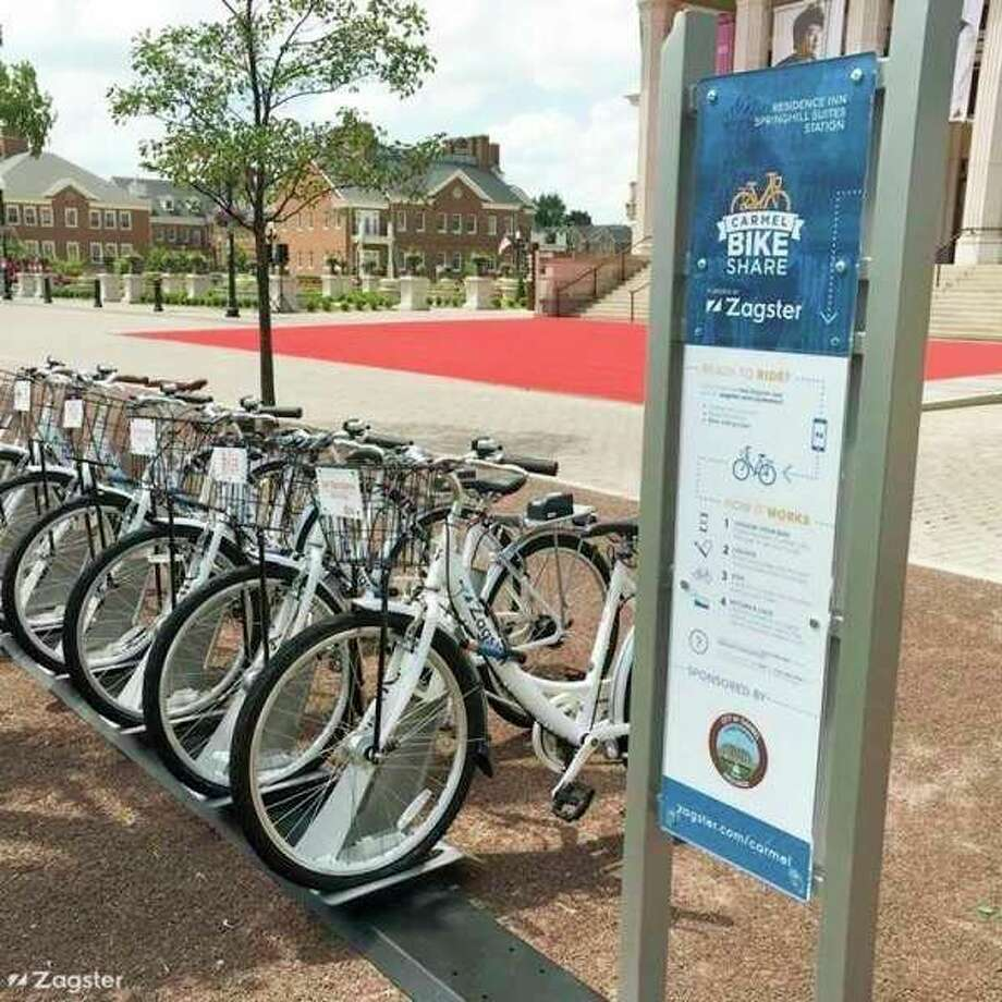 FILE — Zagster bikes sit on a bike share rack in Carmel, Indiana. They are the same model as Bike Midland bikes, which just completed its first season. (Photo Courtesy of Zagster)