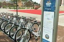 Zagster bikes sit on a bike share rack in Carmel, Indiana. They are the same model as Bike Midland bikes, which just completed its first season. (Photo Courtesy of Zagster)