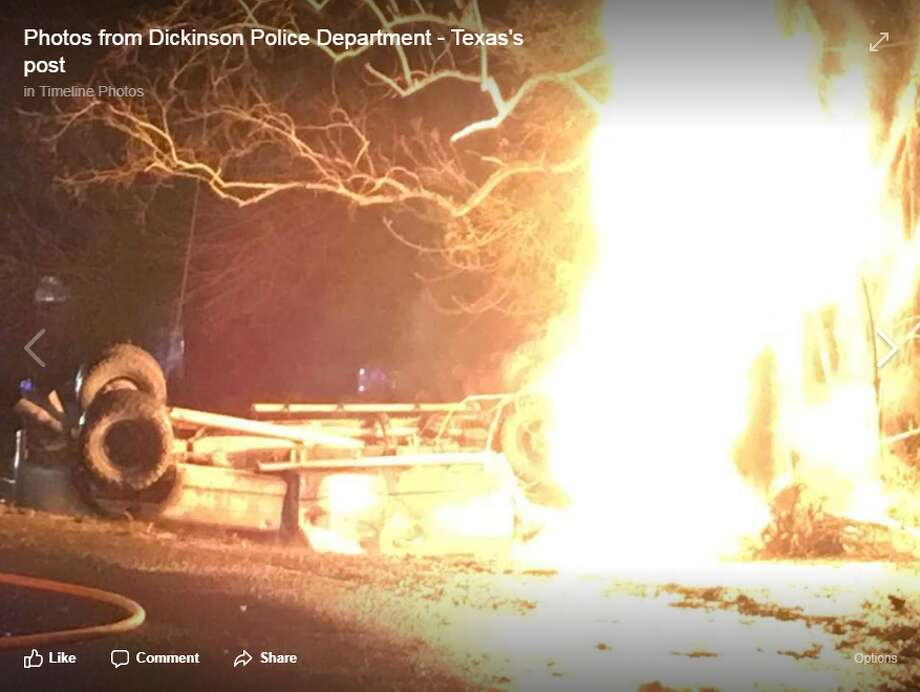 A screenshot of a Dickinson Police Department Facebook photo of the blazing pickup after it crashed into a utility pole, shot by i45-NOW.