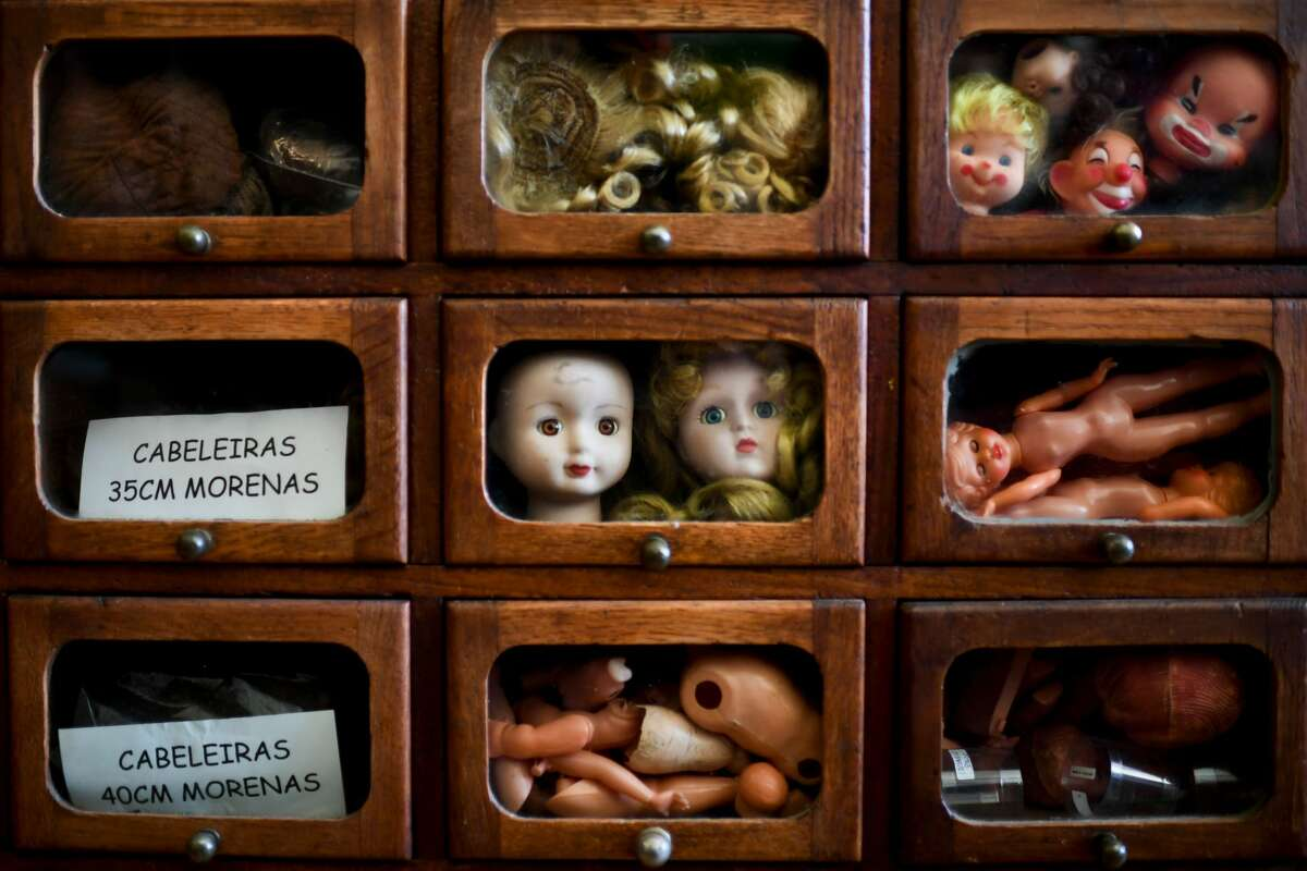A picture shows drawers with different doll parts at the Doll Hospital in Lisbon on December 12, 2017. These delicate toys have been restored or collected with care and affection for five generations, at the