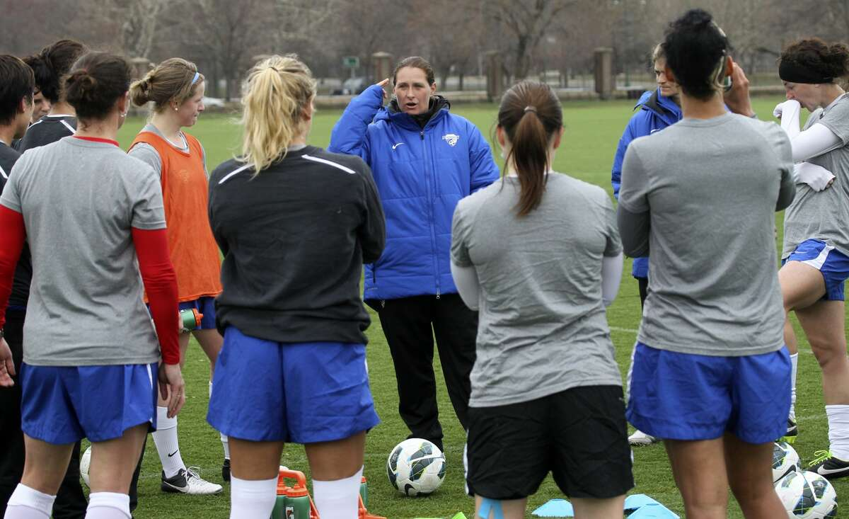 BOSTON - APRIL 11: Boston Breakers head coach Lisa Cole talks to her team during practice at Cumnock Field by Harvard Stadium. (Photo by Bill Greene/The Boston Globe via Getty Images)