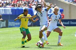 09 July 2016: South Africa midfielder Linda Motlhalo (8) watches United States forward Christen Press (12) control the ball next to United States midfielder Allie Long (23) during a game between South Africa and USA at Soldier Field in Chicago, IL. (Photo by Patrick Gorski/Icon Sportswire via Getty Images)