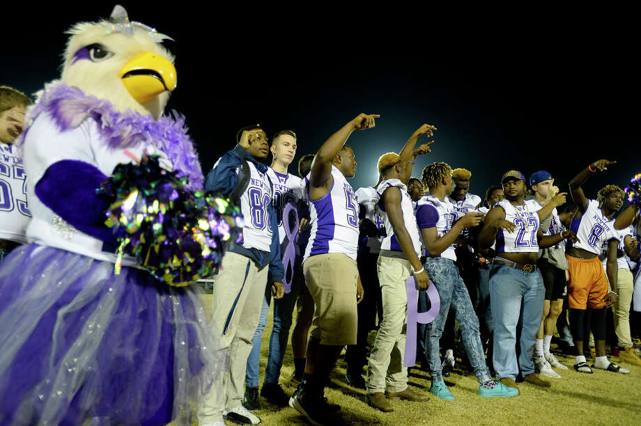 Newton players sing along with the school song during a pep rally Tuesday night to cheer on the team before they leave for the state championship at AT&T Stadium in Arlington.  Photo taken Tuesday 12/19/17 Ryan Pelham/The Enterprise Photo: Ryan Pelham / ©2017 The Beaumont Enterprise/Ryan Pelham