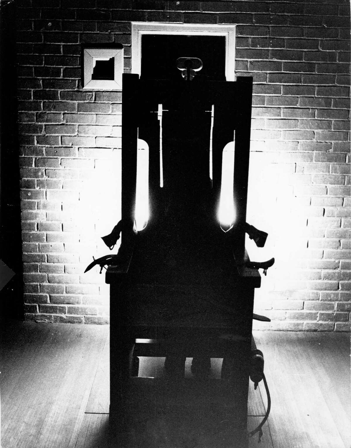 """The Texas electric chair, """"Old Sparky,"""" has been idle more than eight years. It is located at the penitentiary at Huntsville behind a green door on death row."""