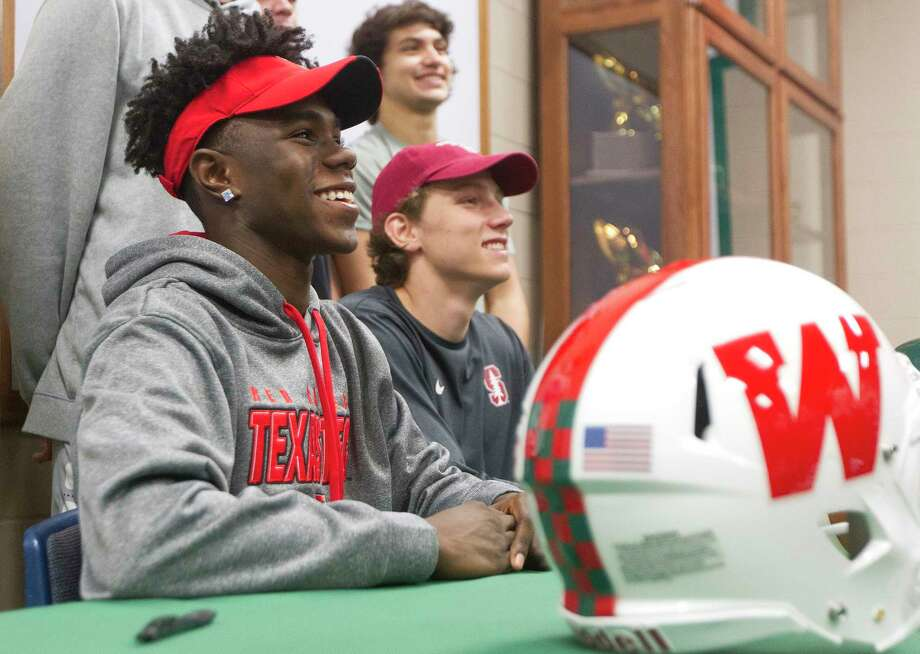 The Woodlands' KeSean Carter, left, poses for a photo next to Ethan Bonner during a signing day ceremony at The Woodlands High School, Wednesday, Dec. 20, 2017, in The Woodlands. Carter and Bonner signed their National Letter of Intent to play football for Texas Tech and Stanford respectively. Photo: Jason Fochtman, Staff Photographer / © 2017 Houston Chronicle