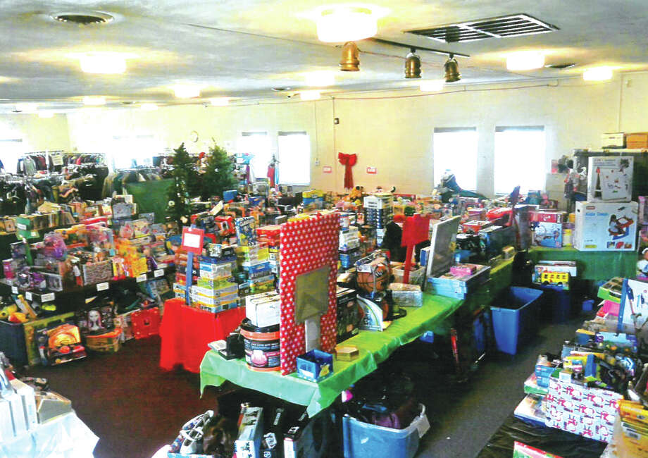 Awaiting the arrival of the Glen Ed Pantry Parents is Santa's storeroom. Glen Ed Parents may choose gifts for their children from this store. Santa's elves Amy Poos and Amy Schuett helped organize the room. Photo: For The Intelligencer