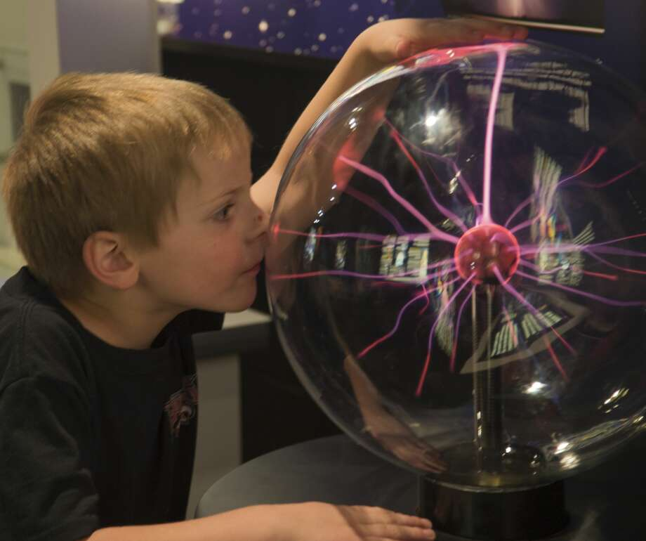 Andrew Stubbs plays with a plasma ball before he and others fill the planetarium 04-07-17 for SciFriday Family Night with a showing of Wall-E in Blakemore Planetarium.  Tim Fischer/Reporter-Telegram Photo: Tim Fischer/Midland Reporter-Telegram