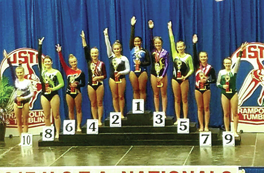 Edwardsville's Rachael Gray stands atop the podiumafter finishing first in the Girls Level 8 United States Tumbling Association Games. She also placed first in the 2017 United States Gymnastics Nationals. Photo: For The Intelligencer