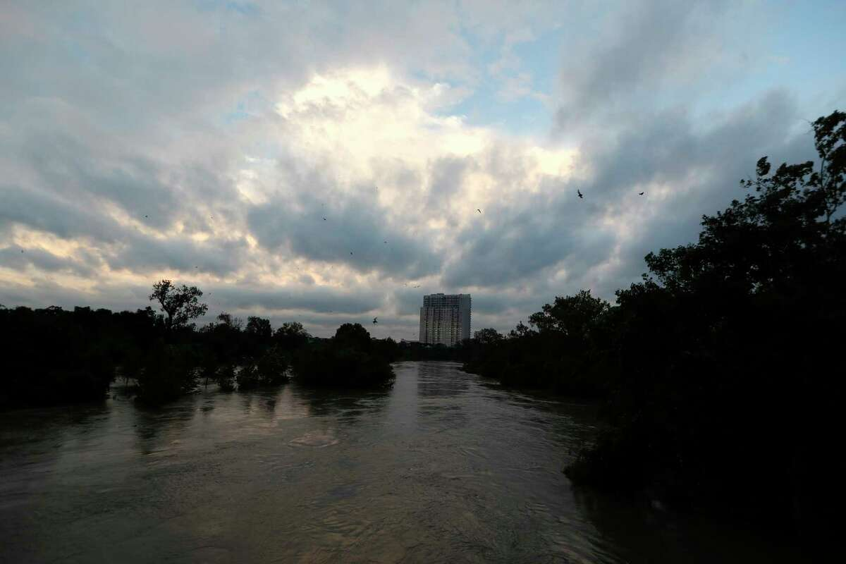 The sun sets over Houston at the Waugh Street bridge with a few surviving bats flying out, hours after the final rains from Tropical Storm Harvey subsided earlier in the day Tuesday, Aug. 29, 2017, in Houston. ( Karen Warren / Houston Chronicle )