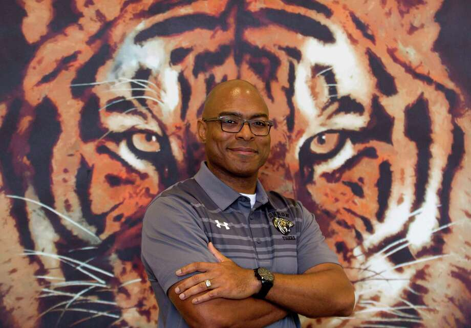 Conroe head football coach Cedric Hardeman poses for a portrait at Conroe High School, Wednesday, Dec. 20, 2017, in Conroe. Hardeman, former defensive and recruiting coordinator with Alief Taylor High School, takes over the program from retiring coach Robert Walker. Photo: Jason Fochtman, Staff Photographer / © 2017 Houston Chronicle