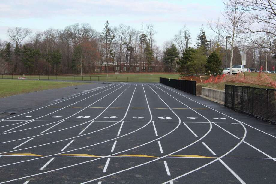 The New Canaan High School track is fully operational but will not be completely finished until another top layer is placed next summer. Photo: Humberto J. Rocha / Hearst Connecticut Media / New Canaan News