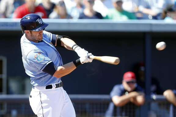 PORT CHARLOTTE, FL - MARCH 6: Evan Longoria #3 of the Tampa Bay Rays hits a double during the third inning of an MLB spring training game against the Minnesota Twins on March 6, 2016 at Charlotte Sports Park in Port Charlotte, Florida.  (Photo by Brian Blanco/Getty Images)