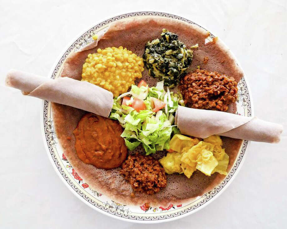 "A traditional meal offering enjoyed by Ethiopian families. Part of the ""Food As Art"" presentation at at the Heritage Society. Photo: The Photo Is By Katie Floyd, Courtesy Of Angel Quesada"