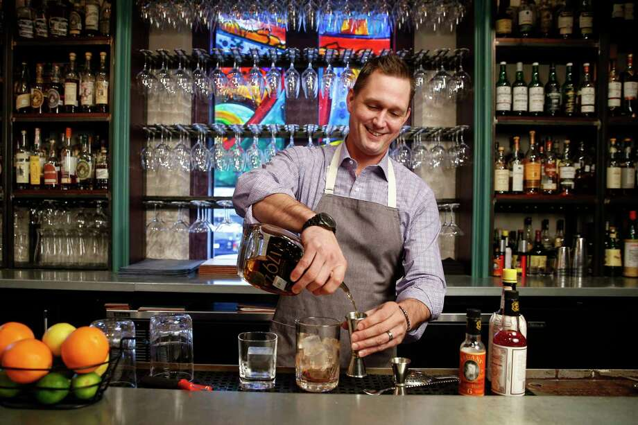 One Fifth Romance Languages bartender Eli Beckmann makes an Old Fashioned Thursday, Dec. 7, 2017 in Houston.( Michael Ciaglo / Houston Chronicle) Photo: Michael Ciaglo, Houston Chronicle / Michael Ciaglo