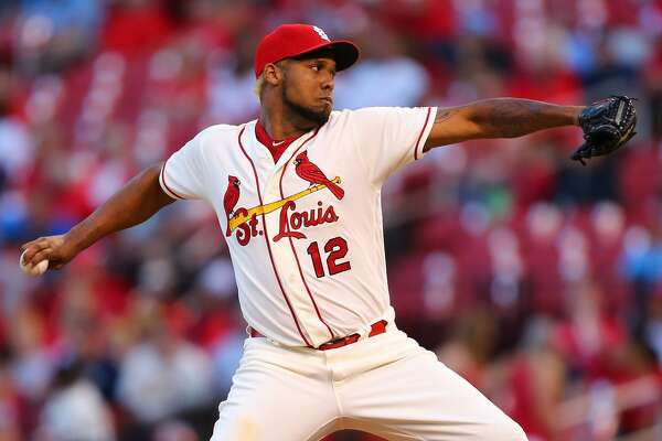 ST. LOUIS, MO - SEPTEMBER 30: Juan Nicasio #12 of the St. Louis Cardinals delivers a pitch against the Milwaukee Brewers in the ninth inning at Busch Stadium on September 30, 2017 in St. Louis, Missouri.  (Photo by Dilip Vishwanat/Getty Images)