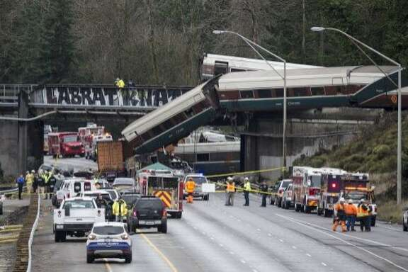 DUPONT, WASHINGTON - DECEMBER 18:  Emegency crews work at the scene of a Amtrak train derailment on December 18, 2017 in DuPont, Washington. At least six people were killed when a passenger train car plunged from the bridge. The derailment also closed southbound I-5.  (Photo by Stephen Brashear/Getty Images) ***BESTPIX***