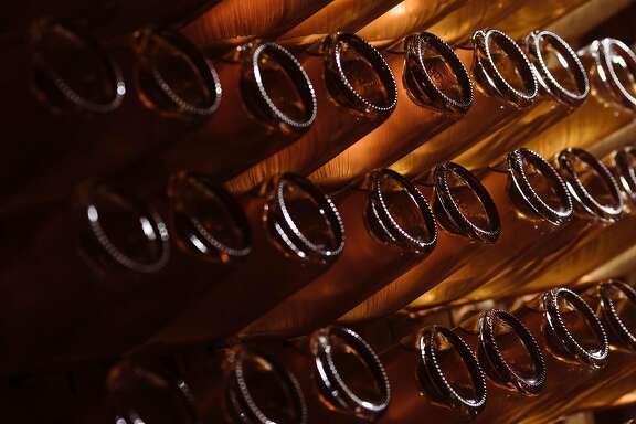 Bottles of sparkling ros� sit in the cellar of Beauregard Vineyards in Santa Cruz, Calif. Friday, December 1, 2017.