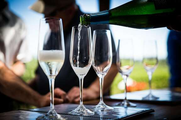 Sparkling wine is poured for tasting at Iron Horse Vineyards in Sebastopol, California on July 6, 2017.