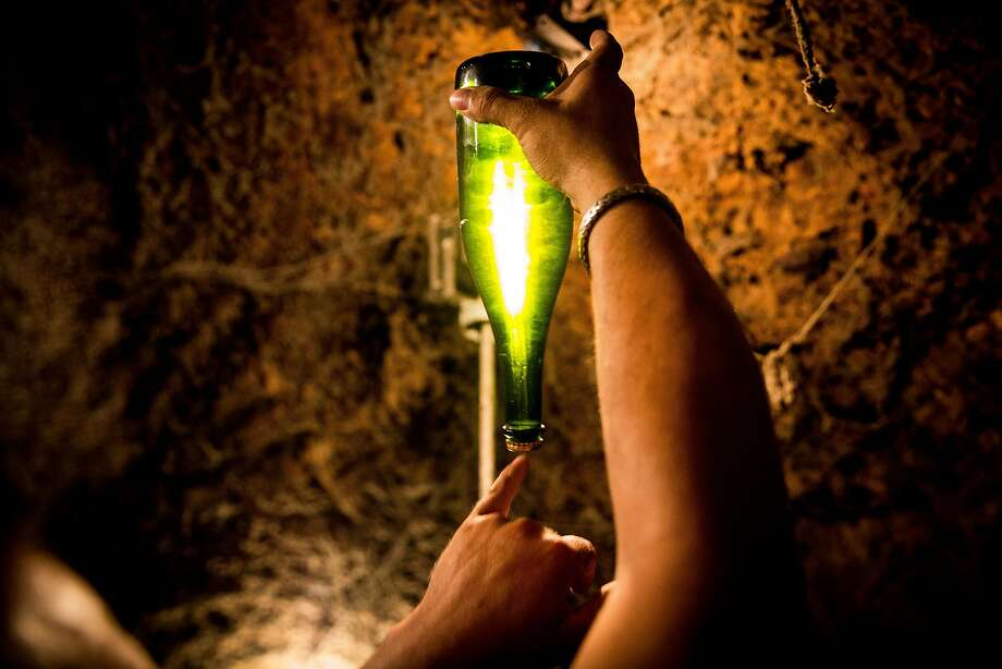 Master riddler Jesus Calderon points out the accumulating yeast in a bottle of sparkling wine in a wine cave at Schramsberg Vineyards in Calistoga. Photo: Max Whittaker/Prime, Special To The Chronicle