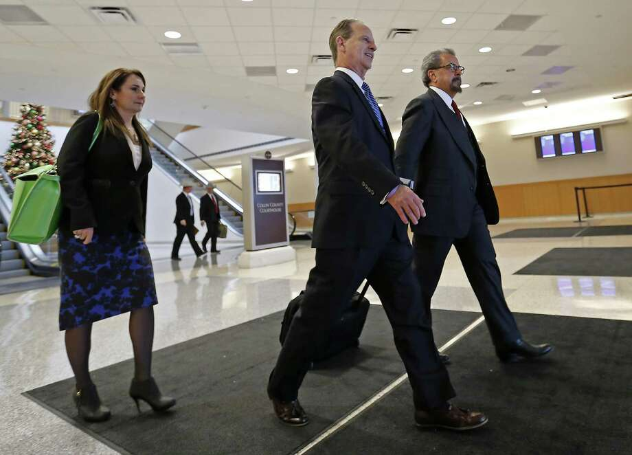 Special prosecutors Nicole DeBorde, Brian Wice (center) and Kent Schaffer leave the Collin County courthouse in 2015. Should the court decide against paying the special prosecutors, the three Houston-level attorneys have threatened to quit the case. That would cause prosecution of the more than 2-year-old case against Paxton to start over. Photo: Dallas Morning News File Photo / The Dallas Morning News