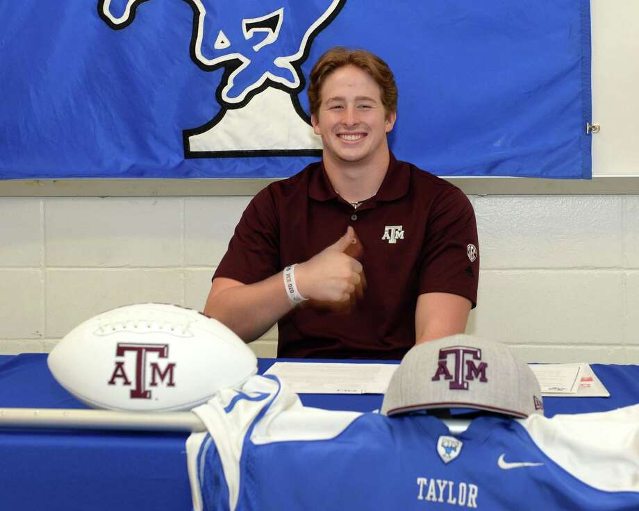 Max Wright poses after signing a commitment to play football at Texas A&M at Taylor High School in Katy, TX on Saturday, December 20, 2017.Browse through the photos to see the top talent available after the early signing period. Photo: Craig Moseley, Chronicle / ©2017 Houston Chronicle