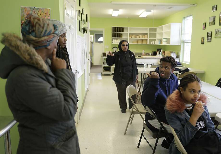 Retired chemist Aster Bekele started an urban farm in one of Indianapolis' roughest neighborhoods to teach at-risk kids how to garden. Photo: Darron Cummings, Associated Press